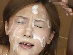 Japanese hottie covered in cum